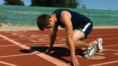 Track runner at starting line, slow motion - stock footage