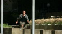 Free runner leaps across concrete blocks, slow motion - stock footage