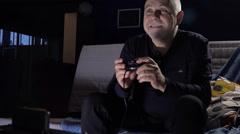Adult Male With a Game Console in a Dark Room Cafe With Passion Keen Computer Stock Footage