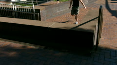 Free Runner vaults over brick divider, slow motion Stock Footage