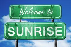 sunrise vintage green road sign with blue sky background - stock illustration