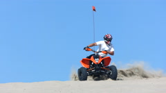 Riding quad in sand, slow motion - stock footage