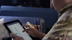 Young Man Through the Tablet by Mail Binds the Evening in a Cafe, Print Text in Stock Footage