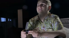 A Young Man With a Game Console in a Dark Room Cafe With Passion Keen Computer Stock Footage