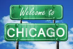 chicago vintage green road sign with blue sky background - stock illustration