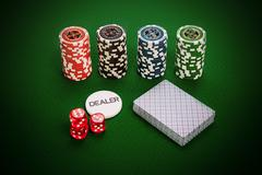 Casino atributes lying on green cloth - stock photo