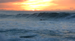 Surfer wipes out at sunset, slow motion Stock Footage
