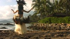 Polynesian dancer performs along rocky coastline, slow motion Stock Footage