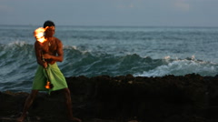 Hawaiian fire knife dancer performs by ocean, slow motion Arkistovideo