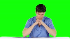 Doctor examines an x-ray knees. Green screen Stock Footage