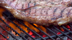 Turning steak of South African barbecue braai grill - stock footage