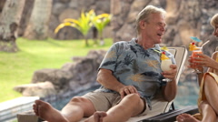 Senior couple at tropical resort - stock footage