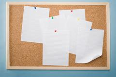 Paper on a noticeboard - stock photo