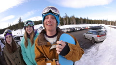 Group of snowboarders make faces, fisheye shot - stock footage