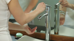 Closeup of woman washing hands in bathroom sink Stock Footage