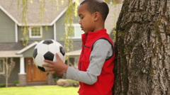 Boy playing soccer - stock footage