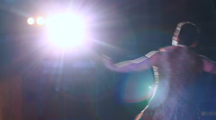 Man dancing on stage at a local festival. - stock footage