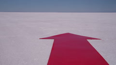 Red arrow at salt flat, dolly movement Stock Footage