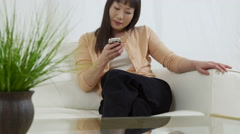 Asian woman talking on phone Stock Footage