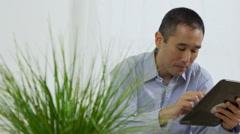 Asian man using digital tablet Stock Footage