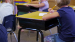 Portrait of elementary school student at desk Stock Footage