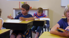 Elementary school student reading book Stock Footage