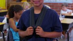 Portrait of elementary school boy in classroom Stock Footage