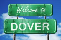 Dover vintage green road sign with blue sky background Stock Illustration