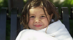 Portrait of young girl drying off with towel Stock Footage