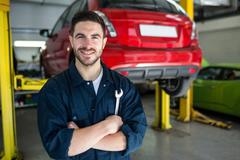 Mechanic with arms crossed and spanner Stock Photos