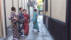 Young Japanese women in traditional dress taking selfie Stock Footage