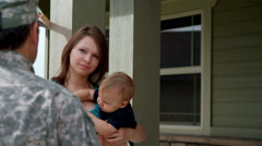 Young woman and baby say goodbye to soldier Stock Footage