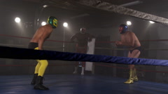Masked wrestlers fight in ring Stock Footage