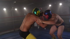 Masked wrestlers fighting in ring, slow motion Stock Footage