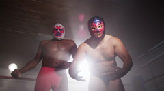 Two masked wrestlers intimidating opponent Stock Footage