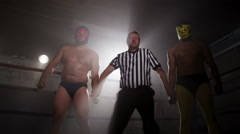 Referee announces winner of wrestling match - stock footage