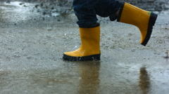 Running through puddles, slow motion Stock Footage