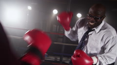 Businessmen boxing in ring Arkistovideo