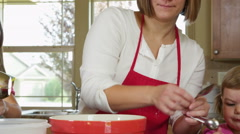Mom baking with daughters Stock Footage
