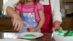 Mother and daughter decorating Christmas cookies Stock Footage