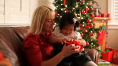 Mother and daughter opening Christmas gift - stock footage