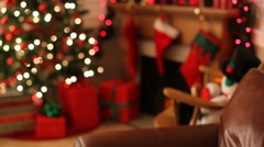 Young boy sleeps on couch Christmas eve Stock Footage