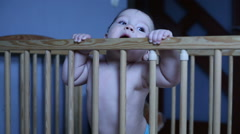 Sweet baby playing in a crib Stock Footage