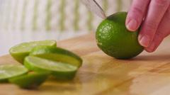 Slicing fresh limes, closeup Stock Footage