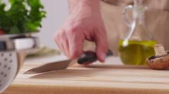 Chopping artichoke, closeup Stock Footage