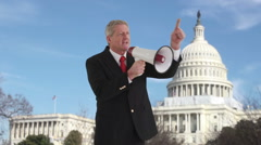 Politician with megaphone in front of US Capitol - stock footage