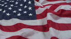 Money falling on American flag Stock Footage