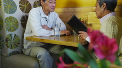 Senior asian couple having dinner Stock Footage