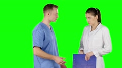 Young medical staff talking together. Doctor scolds intern. Green screen Stock Footage