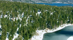 Forest and frozen pond near Big Bear, California Stock Footage